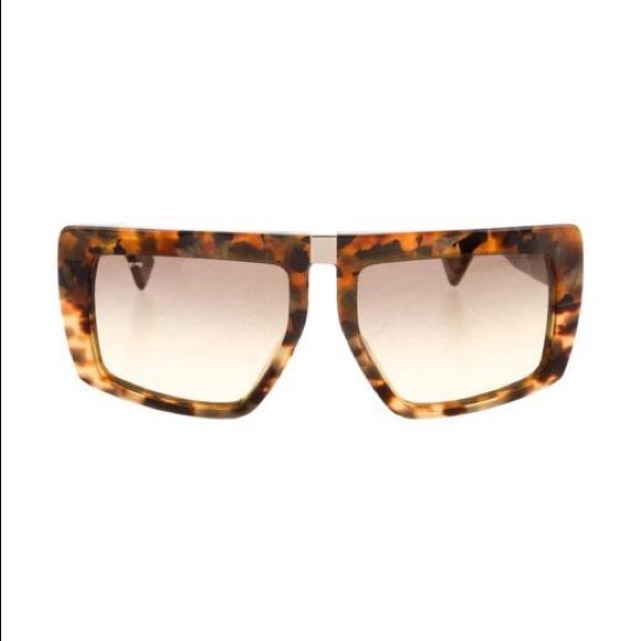 88478e777a9 Miu Miu flat top tortoise sunglasses